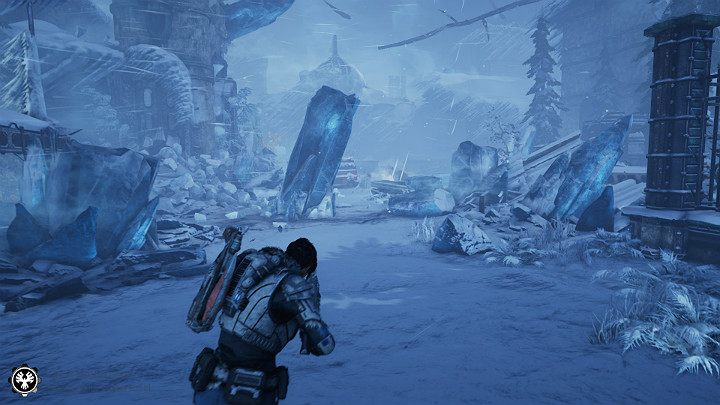 Besides the harsh weather conditions, you also have to face an enemy with a machine weapon guarding the entrance to the research facility - Act 2 Chapter 3 - Forest for the trees | Gears 5 Walkthrough - Act II - Gears 5 Guide