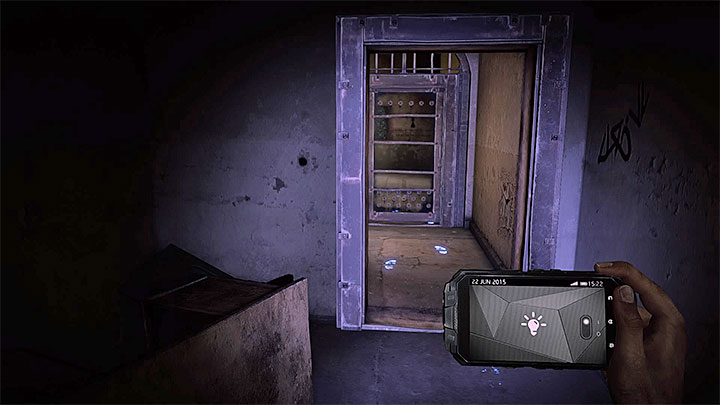 When exploring block B of the asylum, you will pass by John Keatings cell and reach the locked door presented in the screenshot - How to deal with the electronic door in the asylum (Black)? - Solving the puzzles - Get Even Game Guide