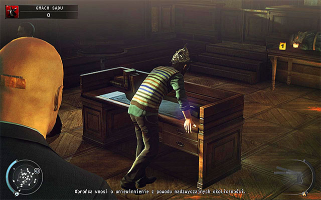 The person, whose identity you can still is Timothy Hawke and you can find him in the courtroom (screen above) - Courthouse - Getting to the holding cells in defendant disguise - 15: Skurkys Law - Hitman: Absolution - Game Guide and Walkthrough