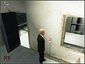 Stand in the spot shown on the screenshot above and wait for the guard to approach the coke machine and sneak into his room to hit the switch that turns of the lasers ahead - You Better Watch Out - Walkthrough - Hitman: Blood Money - Game Guide and Walkthrough