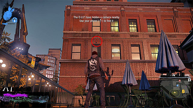 2) Hidden Camera - The camera you seek is in the place shown in the above screenshot - Downtown - more difficult activities - City - inFamous: Second Son - Game Guide and Walkthrough