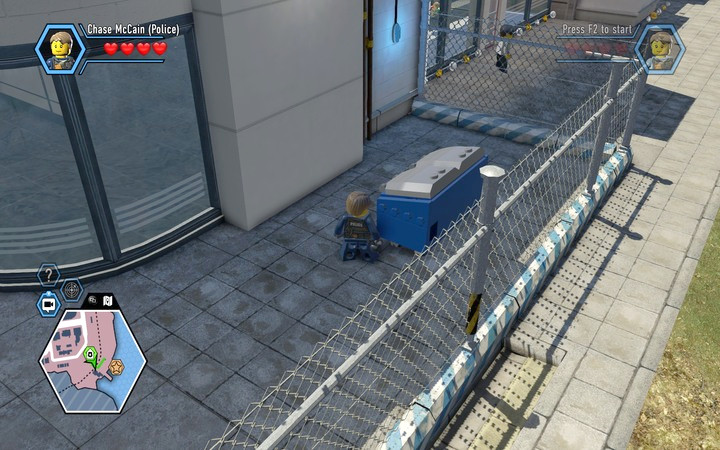 The garbage cans in the blue and white colour are often used as a safeguard in order to pass through the fence - The prison island | Chapter 3 - Chapter 3 - LEGO City: Undercover Game Guide