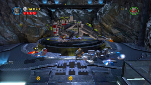 Use rockets to destroy all silver bricks near the platform with dinosaur and use remaining brick to build platform for trackball (picture) - Unwelcome Guests | Walkthrough - Walkthrough - LEGO Batman 2: DC Super Heroes Game Guide & Walkthrough