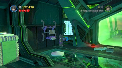 Take it and go to the blue wall on the left (picture) - Destination Metropolis | Walkthrough - Walkthrough - LEGO Batman 2: DC Super Heroes Game Guide & Walkthrough