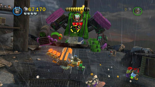 Destroy two crates standing in the centre and use bricks to build a gun - Tower Defiance | Walkthrough - Walkthrough - LEGO Batman 2: DC Super Heroes Game Guide & Walkthrough