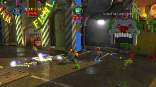 After that move to the top right corner of the location and use bricks to build a Jokers face on the wall (picture) - Harboring a Criminal | Walkthrough - Walkthrough - LEGO Batman 2: DC Super Heroes Game Guide & Walkthrough