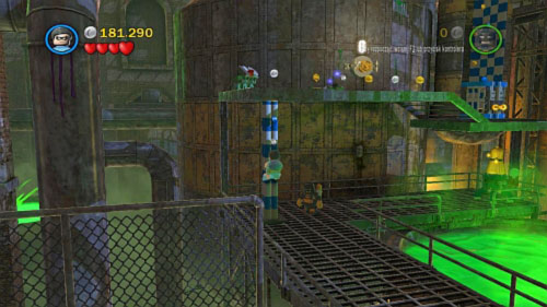 In the next area destroy silver bricks on the right side and use pole to move Robin on the higher floor (picture) - Chemical Crisis | Walkthrough - Walkthrough - LEGO Batman 2: DC Super Heroes Game Guide & Walkthrough