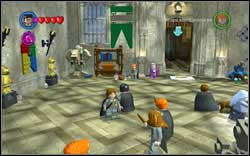 Use magic on the green banner above the door to the Great Hall, the student is inside - Bonuses - Hogwarts - Walkthrough - LEGO Harry Potter: Years 1-4 - Game Guide and Walkthrough