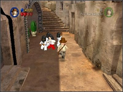 You will be immediately attacked by enemies with swords - Chapter 3 - City of Danger - part 1 - Riders of the Lost Ark - LEGO Indiana Jones: The Original Adventures - Game Guide and Walkthrough