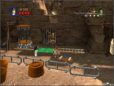 Almost immediately you will be attacked by enemies - Chapter 5 - Pursuing the Ark - Riders of the Lost Ark - LEGO Indiana Jones: The Original Adventures - Game Guide and Walkthrough