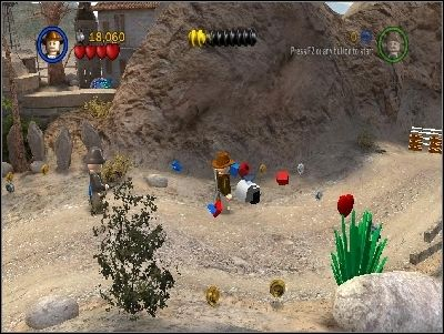 Now you must destroy three tractors and take LEGO pieces to the green pads near the house - Chapter 4 - Trouble in the Sky - The Last Crusade - LEGO Indiana Jones: The Original Adventures - Game Guide and Walkthrough