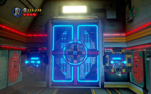 When the door is open, run towards the corridor and cover yourself with a shield - you will be targeted by another cannon - Rebooted, Resuited - Walkthrough - LEGO Marvel Super Heroes - Game Guide and Walkthrough