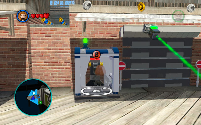 Go to the destination point and use Black Widow's invisibility power to avoid cameras - S.H.I.E.L.D. Helicarrier / New York - Walkthrough - LEGO Marvel Super Heroes - Game Guide and Walkthrough