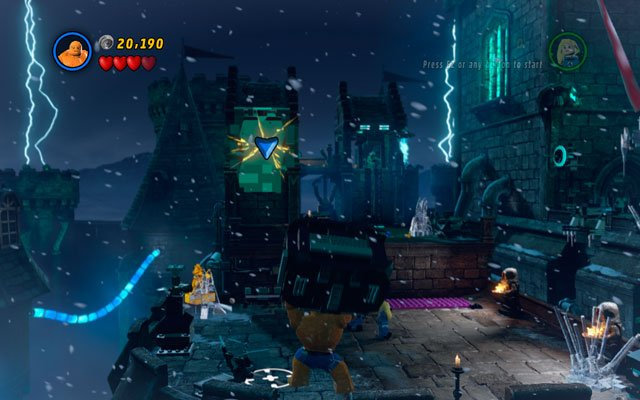 Land at the one of the castle towers, then fight the enemies crowded nearby - Doctor in the House - Walkthrough - LEGO Marvel Super Heroes - Game Guide and Walkthrough