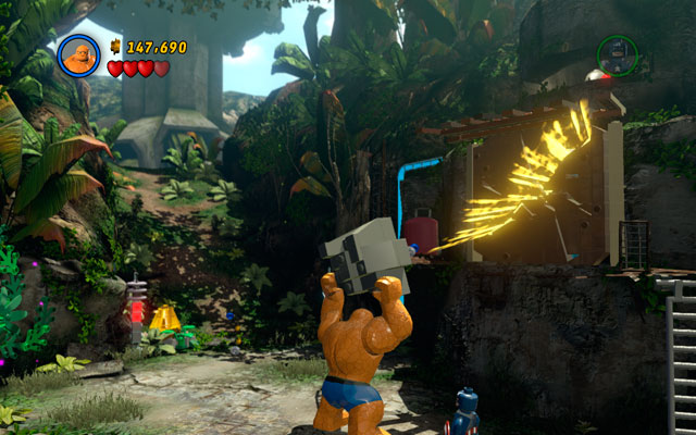 Choose the Thing and lift a rock with green handles attached to it, then throw it at the enemies - Rapturous Rise - Walkthrough - LEGO Marvel Super Heroes - Game Guide and Walkthrough