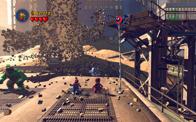 On the right side of the sand giant you will find silver obstacle, which only Iron Man can destroy - Sandman - Boss fights - LEGO Marvel Super Heroes - Game Guide and Walkthrough