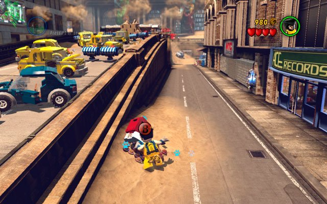 At the beginning of the stage jump down from the street and turn right, looking for the pizza motorcycle - dig it up with Wolverine - Sand Central Station - Minikit Sets - LEGO Marvel Super Heroes - Game Guide and Walkthrough