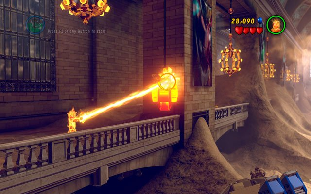 Enter to the station and then choose Human Torch - fly to the balcony on the left side of the building and melt the golden device attached to the pillar, using fire beam - Sand Central Station - Minikit Sets - LEGO Marvel Super Heroes - Game Guide and Walkthrough