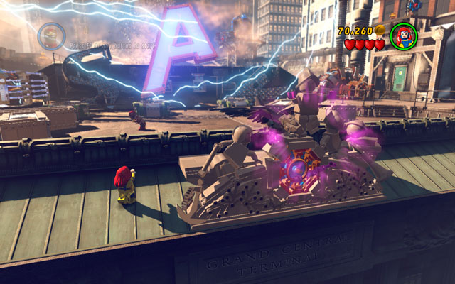 During the first stage of the boss fight turn your character back and approach to the big clock, located on the top of the building - Sand Central Station - Minikit Sets - LEGO Marvel Super Heroes - Game Guide and Walkthrough