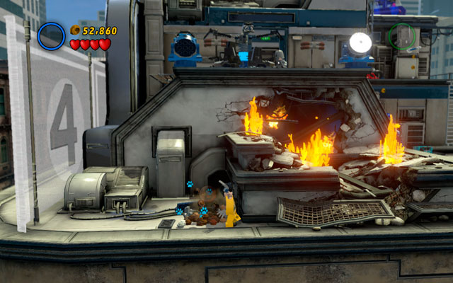 When standing on the roof, descend to the lower floor and break all crates laying on the left - Times Square Off - Minikit Sets - LEGO Marvel Super Heroes - Game Guide and Walkthrough