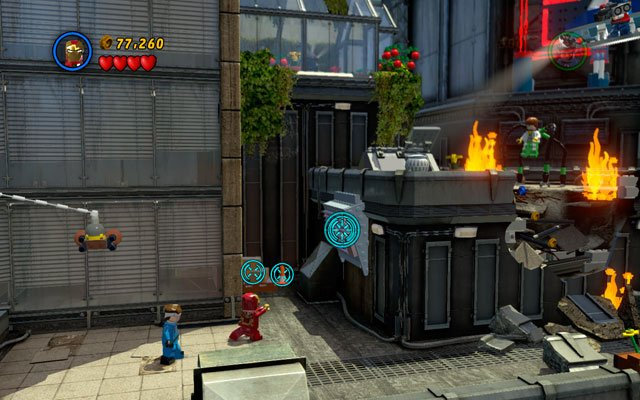 Standing vis-a-vis to the HOTEL neon choose Iron Man and shoot the rockets at the silver bar - Times Square Off - Minikit Sets - LEGO Marvel Super Heroes - Game Guide and Walkthrough