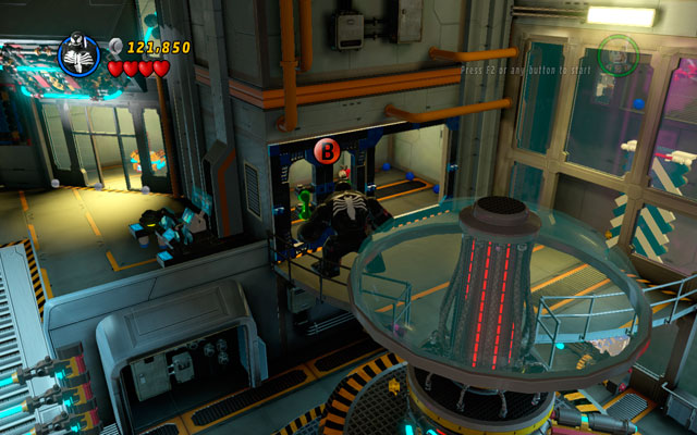 In the room with strange, rotary machine (on the left from the blue-and-white wall) choose any big character and yank the door located on the first floor, using green handles - Rebooted, Resuited - Minikit Sets - LEGO Marvel Super Heroes - Game Guide and Walkthrough