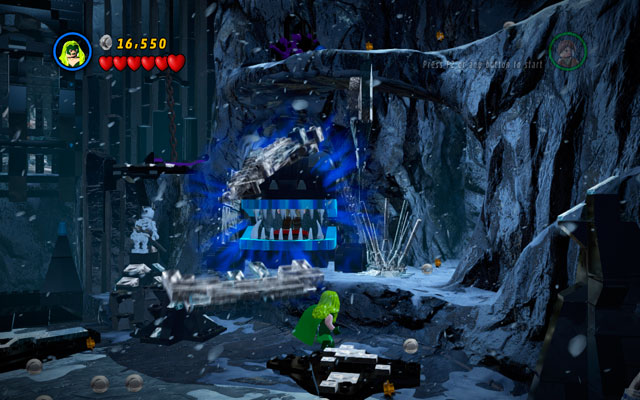 To rescue Stan Lee, choose Magneto or Polaris and - with their special powers - open the metal jaws placed on the right side of the gate - Deadpool Bonus Missions - Stan Lee in Peril - LEGO Marvel Super Heroes - Game Guide and Walkthrough