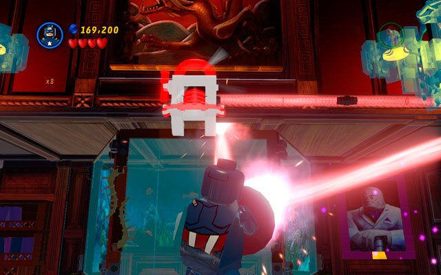 Rotate yourself to direct the laser beam on the red generator placed above the aquarium (with Kingpin hidden inside) - Feeling Fisky - Deadpool Bonus Missions: Walkthrough - LEGO Marvel Super Heroes - Game Guide and Walkthrough