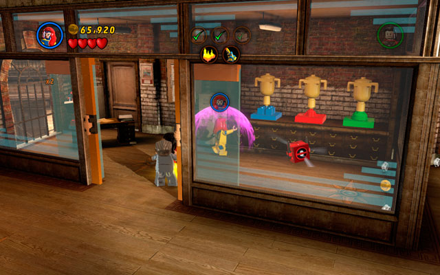 In order to find Deadpool brick, enter the office with Deadpool hidden inside and use Jeans telekinesis power to put nearby chalices in to the right places (the color of basis should be the same as on chalice) - Tabloid Tidy Up - Deadpool Bonus Missions: Collectables - LEGO Marvel Super Heroes - Game Guide and Walkthrough