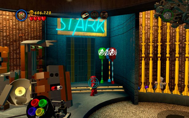 The last bunch of balloons is placed under the STARK neon, next to golden cage with Stan Lee closed inside - House Party Protocol - Deadpool Bonus Missions: Collectables - LEGO Marvel Super Heroes - Game Guide and Walkthrough