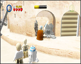 When you reach the square, you'll have to use the parts around to build an AT-ST walker - Mos Eisley Spaceport - Story Mode - Episode IV - LEGO Star Wars II: The Original Trilogy - Game Guide and Walkthrough