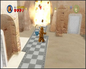 Go to the left, grapple across the street - Mos Eisley Spaceport - Story Mode - Episode IV - LEGO Star Wars II: The Original Trilogy - Game Guide and Walkthrough