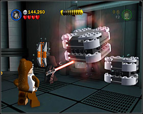 In the room where you position the two crates on the floor, use the Force on the two metal boxes to the right, then jump on them - Secret Plans - Freeplay Mode - Episode IV - LEGO Star Wars II: The Original Trilogy - Game Guide and Walkthrough