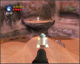 Head to the secret area where you got the power brick and stand at the spot shown on the screenshot - Through the Jundland Wastes - Freeplay Mode - Episode IV - LEGO Star Wars II: The Original Trilogy - Game Guide and Walkthrough