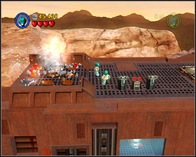 When you get on the roof of Sandcrawler use Detonators to destroy silver things on the back of vehicle. Then two players must stand on the two spots - Through the Jundland Wastes - Freeplay Mode - Episode IV - LEGO Star Wars II: The Original Trilogy - Game Guide and Walkthrough