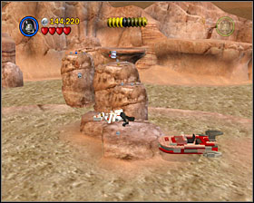 In the last area of the level you'll see a minikit on the rock in the middle of the swamp - Through the Jundland Wastes - Freeplay Mode - Episode IV - LEGO Star Wars II: The Original Trilogy - Game Guide and Walkthrough