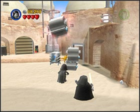 Use the Force on the 3 metal crates and then use them to reach the roof of the nearby shack - Mos Eisley Spaceport - Freeplay Mode - Episode IV - LEGO Star Wars II: The Original Trilogy - Game Guide and Walkthrough