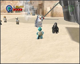 As a Bounty Hunter use the detonator to destroy the shiny metal object shown on the screenshot - Mos Eisley Spaceport - Freeplay Mode - Episode IV - LEGO Star Wars II: The Original Trilogy - Game Guide and Walkthrough