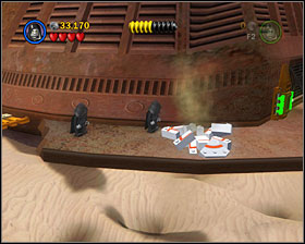 When you're by the mechanism at the front of the barge, use the Dark Side on the crate to create a grapple point - The Great Pit of Carkoon - Freeplay Mode - Episode VI - LEGO Star Wars II: The Original Trilogy - Game Guide and Walkthrough