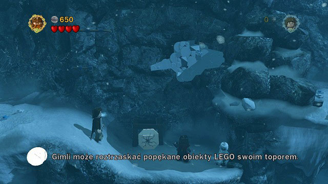 On the other side of the deep snow you will find a broken LEGO tile which Gimli can break to pieces with his axe - The Pass of Caradhras - Walkthrough - Act I - LEGO The Lord of the Rings - Game Guide and Walkthrough