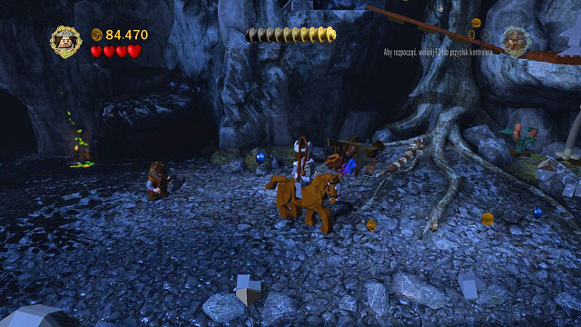 You need to get on a horse and move along the trail of coins - The Pass of Caradhras - Collectibles - LEGO The Lord of the Rings - Game Guide and Walkthrough