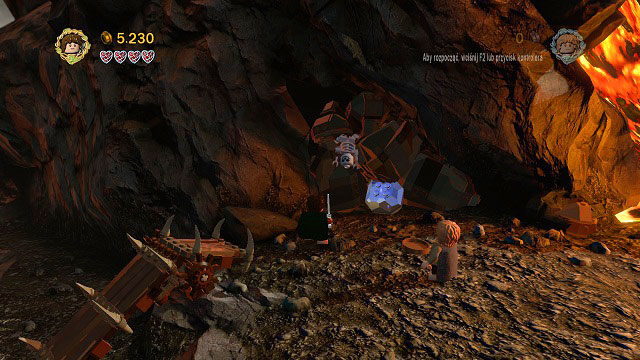 Right after crossing the first ramp you will see a pile of boulders with a skeleton hanging from them - Mount Doom - Collectibles - LEGO The Lord of the Rings - Game Guide and Walkthrough