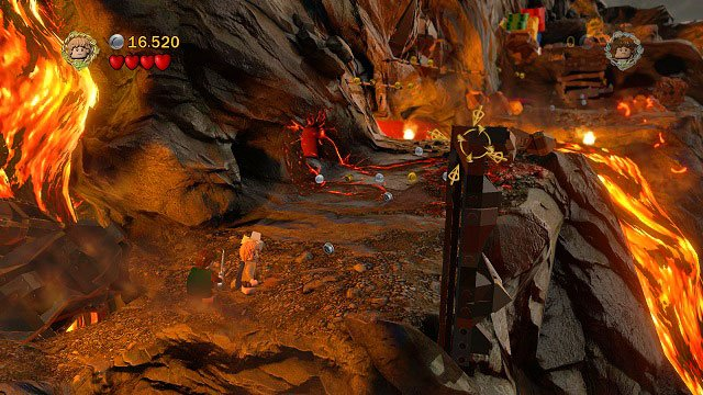 After stopping the river of lave, dig up another stone from the loose ground beneath you and throw it at the pillar on the right - Mount Doom - Collectibles - LEGO The Lord of the Rings - Game Guide and Walkthrough
