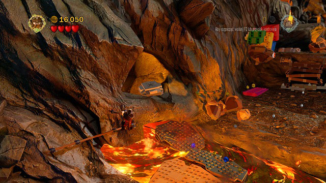In the place where the rocks are falling down, as you're crossing the river of fire while holding onto the rail, you will see a cracked LEGO tile - Mount Doom - Collectibles - LEGO The Lord of the Rings - Game Guide and Walkthrough