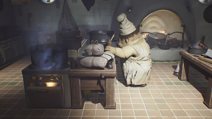 Hide under the table and do not let yourself be detected. - First meeting with the cook | The Kitchen - The Kitchen - Little Nightmares Game Guide
