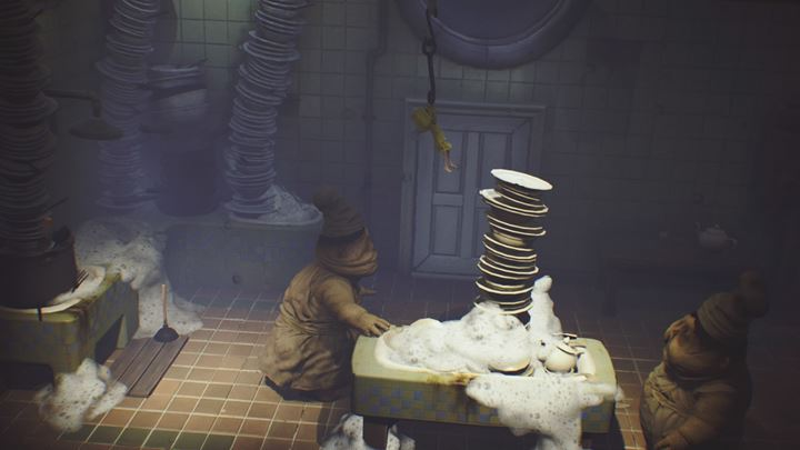 Climb the dishes and grab a hook. - The room with the dirty dishes | The Kitchen - The Kitchen - Little Nightmares Game Guide