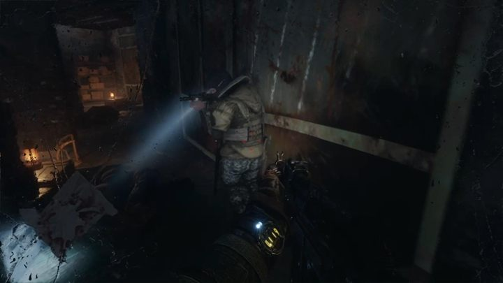 Shoot/deafen enemies until you reach the red door - Moscow - Inside the enemy base - Metro Exodus Walkthrough - Moscow - Metro Exodus Guide