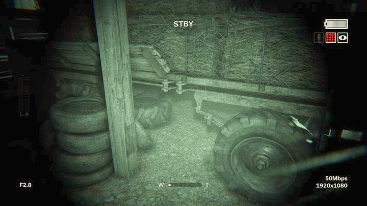 First, walk around the trailer with hay to the right and hide underneath it - The Fields | Genesis | Walkthrough - Genesis - Outlast 2 Game Guide