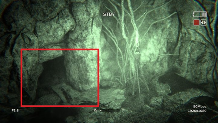 On the left you can see a small hole which is a tunnel that you can crawl into - Descent | Leviticus | Walkthrough - Leviticus - Outlast 2 Game Guide