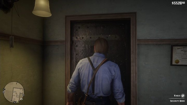 Enter the store and interact with the security door - Store robbery in Red Dead Redemption 2 - Side quests - Red Dead Redemption 2 Guide